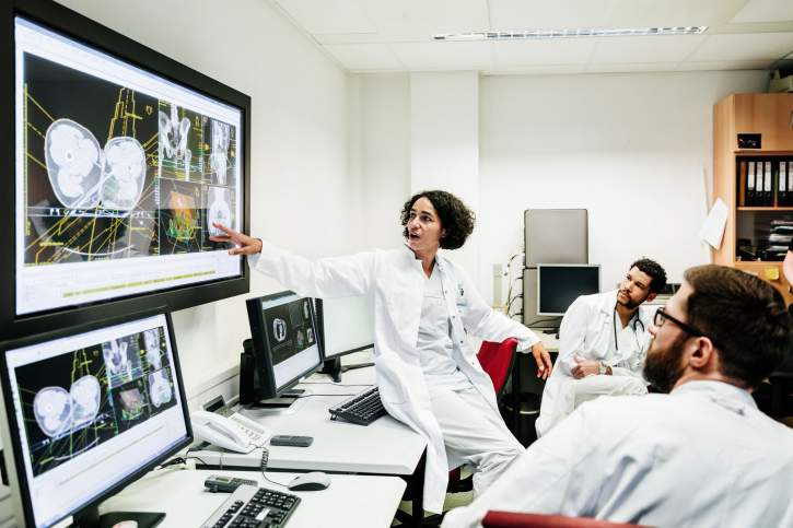 Picture of doctors looking on screens