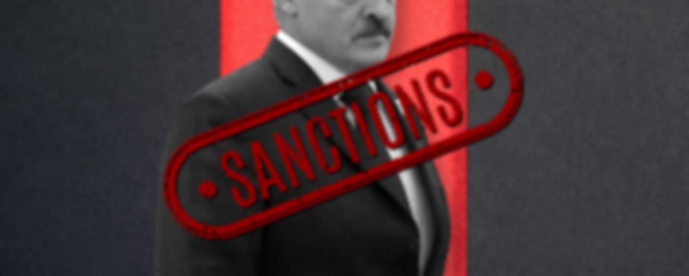 Photo of Lukashenko with a sign